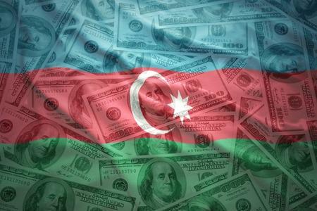 azerbaijani: colorful waving azerbaijani flag on a american dollar money background