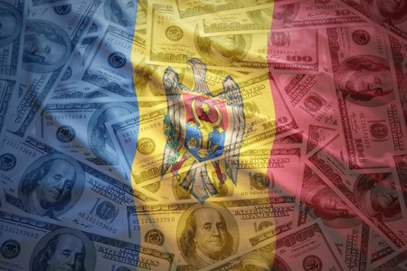 financial stability: colorful waving moldavian flag on a american dollar money background Stock Photo