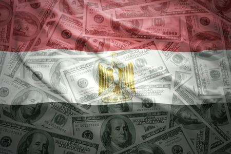 subsidy: colorful waving egyptian flag on a american dollar money background Stock Photo