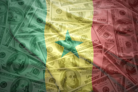 senegalese: colorful waving senegalese flag on a american dollar money background