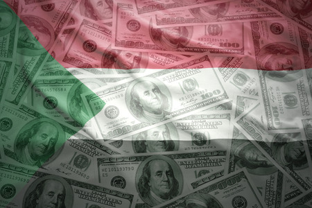 subsidy: colorful waving sudanese flag on a american dollar money background Stock Photo