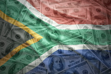 south africa flag: colorful waving south africa flag on a american dollar money background Stock Photo
