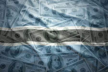 subsidy: colorful waving botswana flag on a american dollar money background