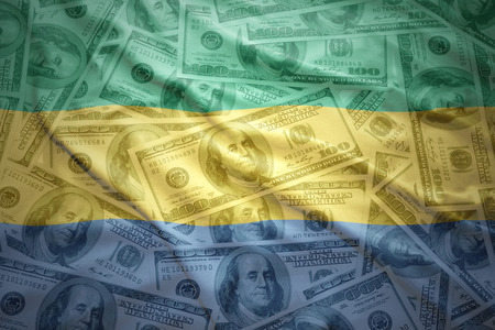 subsidy: colorful waving gabonese flag on a american dollar money background