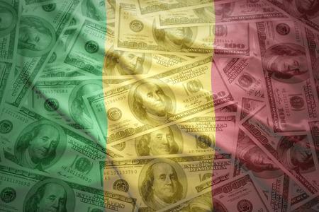 subsidy: colorful waving malian flag on a american dollar money background