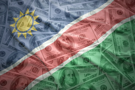 subsidy: colorful waving namibian flag on a american dollar money background Stock Photo