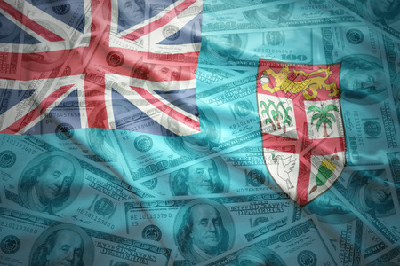subsidy: colorful waving fiji flag on a american dollar money background Stock Photo