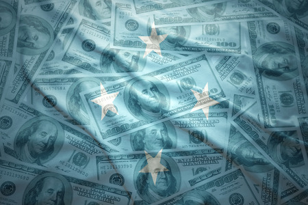 subsidy: colorful waving united States of Micronesia flag on a american dollar money background Stock Photo