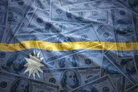 subsidy: colorful waving nauru flag on a american dollar money background Stock Photo