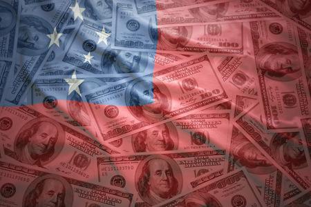 subsidy: colorful waving samoa flag on a american dollar money background