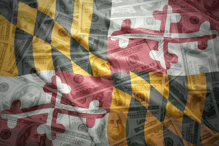 subsidy: colorful waving maryland state flag on a american dollar money background