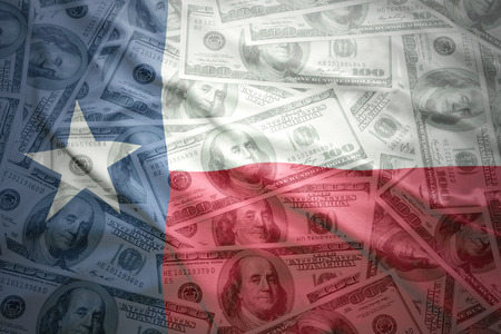 texas state flag: colorful waving texas state flag on a american dollar money background