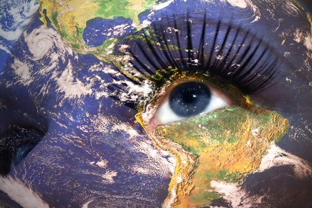 us sizes: womans face with planet Earth texture and alaska state flag inside the eye. Elements of this image furnished by NASA. Stock Photo
