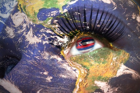 us sizes: womans face with planet Earth texture and hawaii state flag inside the eye.