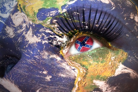 us sizes: womans face with planet Earth texture and confederate navy  jack flag inside the eye.