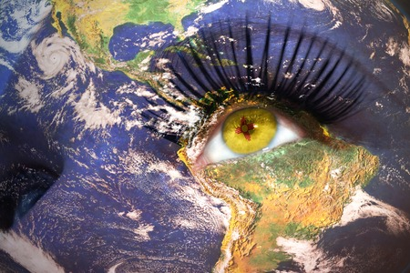 us sizes: womans face with planet Earth texture and new mexico state flag inside the eye. Elements of this image furnished by NASA. Stock Photo