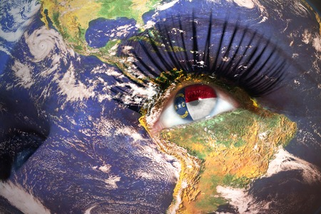 us sizes: womans face with planet Earth texture and north carolina state flag inside the eye.