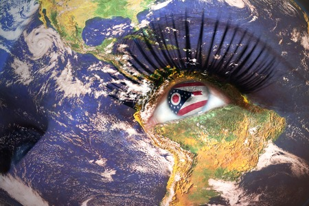 us sizes: womans face with planet Earth texture and ohio state flag inside the eye.