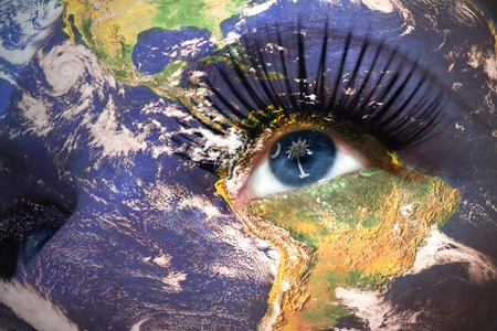 us sizes: womans face with planet Earth texture and south carolina state flag inside the eye. Elements of this image furnished by NASA.