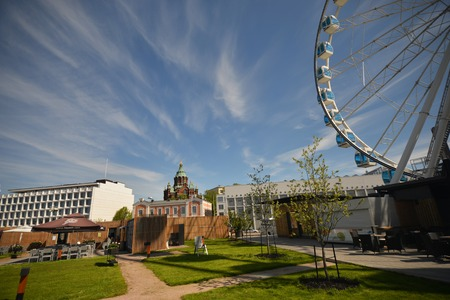 a round of inspection: city view of helsinki with ferris wheel , finland