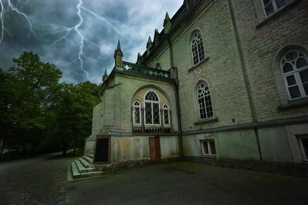 sinister: Ancient mystical sinister house during a thunderstorm Stock Photo