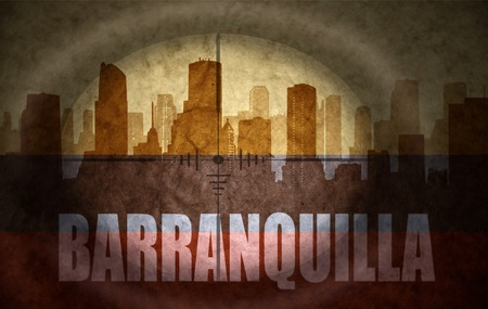 colombian flag: sniper scope aimed at the abstract silhouette of the city with text Barranquilla at the vintage colombian flag. concept Stock Photo