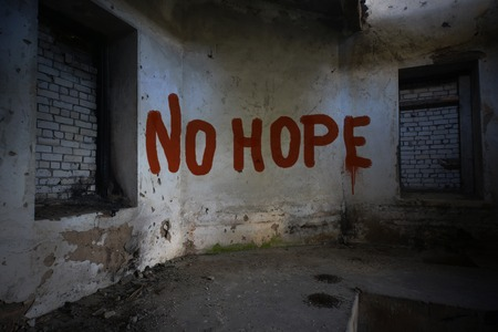roofless: text no hope on the dirty old wall in an abandoned ruined house Stock Photo