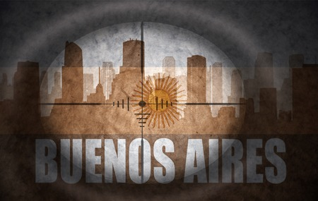 the name of the drug: sniper scope aimed at the abstract silhouette of the city with text Buenos Aires at the vintage argentinian flag. concept Stock Photo