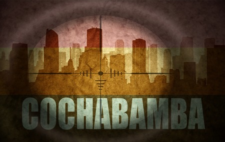 cochabamba: sniper scope aimed at the abstract silhouette of the city with text Cochabamba at the vintage bolivian flag. concept