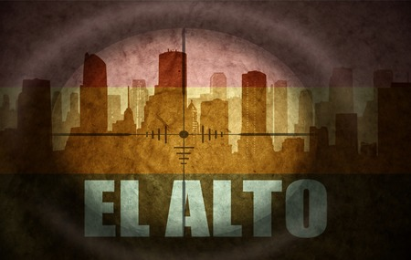 the name of the drug: sniper scope aimed at the abstract silhouette of the city with text El Alto at the vintage bolivian flag. concept Stock Photo
