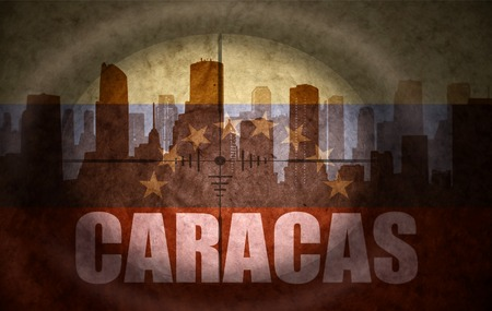the name of the drug: sniper scope aimed at the abstract silhouette of the city with text Caracas at the vintage venezuelan flag. concept
