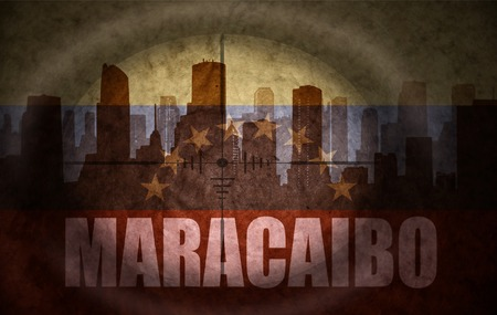 the name of the drug: sniper scope aimed at the abstract silhouette of the city with text Maracaibo at the vintage venezuelan flag. concept