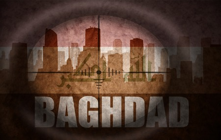 iraqi: sniper scope aimed at the abstract silhouette of the city with text Baghdad at the vintage iraqi flag. concept