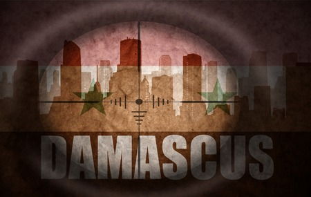 damascus: sniper scope aimed at the abstract silhouette of the city with text Damascus at the vintage syrian flag. concept