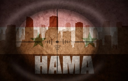 rebel flag: sniper scope aimed at the abstract silhouette of the city with text Hama at the vintage syrian flag. concept