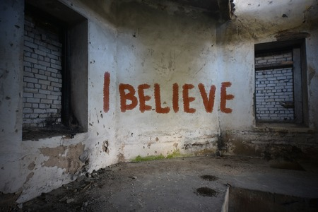 roofless: text i believe on the dirty old wall in an abandoned ruined house