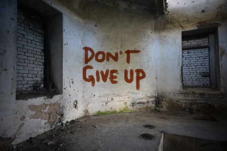 dirtiness: text dont give up on the dirty old wall in an abandoned ruined house