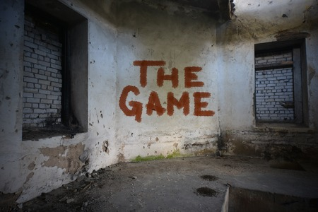 roofless: text the game on the dirty old wall in an abandoned ruined house