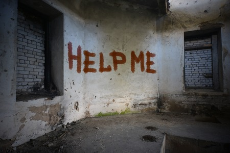 dirtiness: text help me on the dirty old wall in an abandoned ruined house