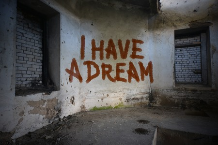 dirtiness: text i have a dream on the dirty old wall in an abandoned ruined house