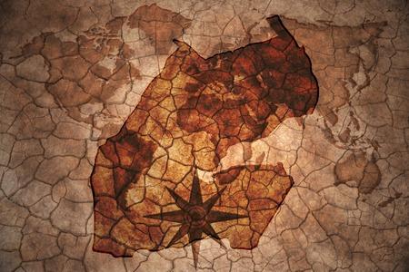 djibouti: djibouti map on vintage crack paper background