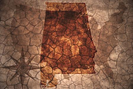 alabama state: Alabama state map on vintage usa map, crack paper background