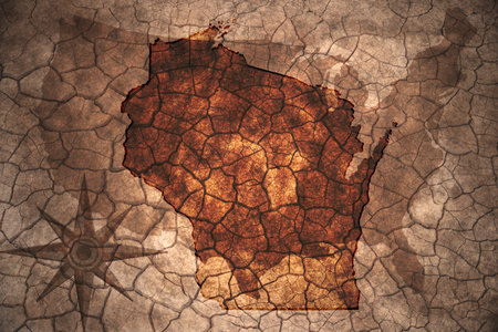 wisconsin state: Wisconsin state map on vintage usa map, crack paper background