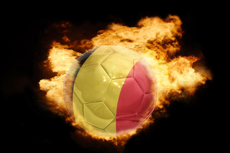 belgium flag: football ball with the national flag of belgium on fire on a black background Stock Photo