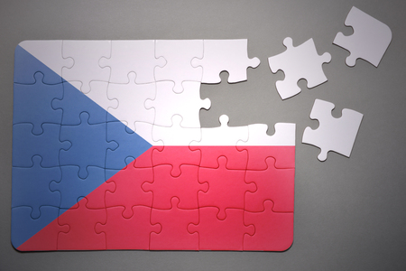 separatism: broken puzzle with the national flag of  czech republic on a gray background Stock Photo
