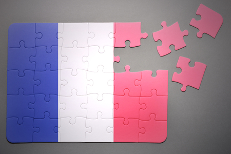separatism: broken puzzle with the national flag of france on a gray background Stock Photo