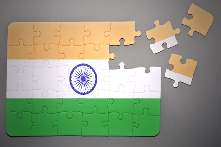 separatism: broken puzzle with the national flag of india on a gray background Stock Photo