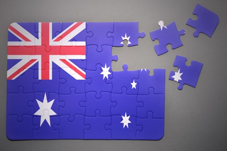 separatism: broken puzzle with the national flag of australia on a gray background Stock Photo