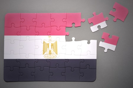 separatism: broken puzzle with the national flag of egypt on a gray background Stock Photo