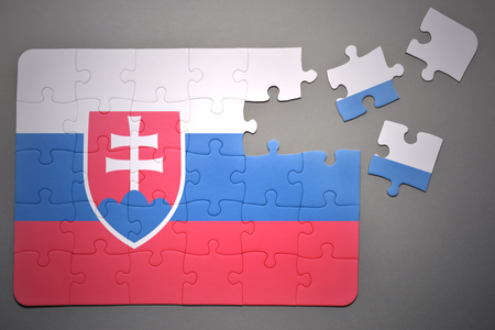 separatism: broken puzzle with the national flag of slovakia on a gray background Stock Photo